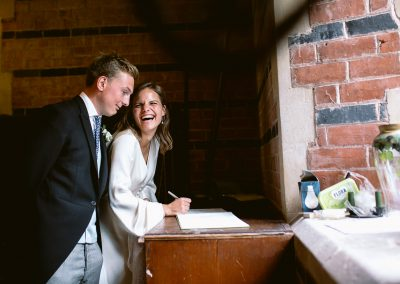 bride and groom signing register best of 2017