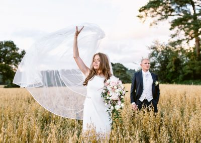 bride and groom standing in the fields best of 2017