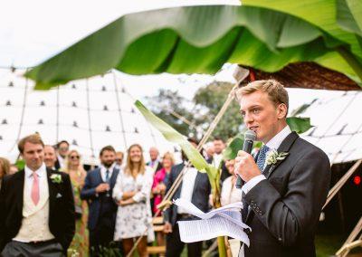 groom speaking under a big fig leaves best of 2017