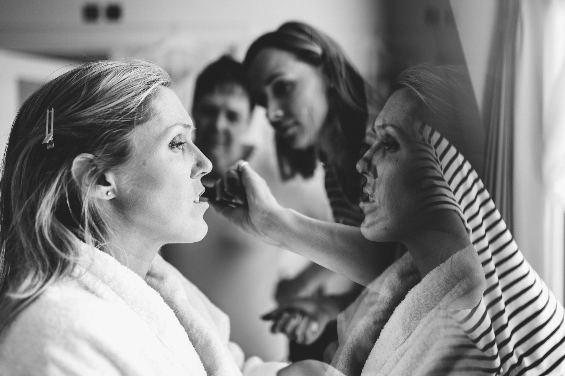 bride having her make up done in salcombe harbour hotel wedding