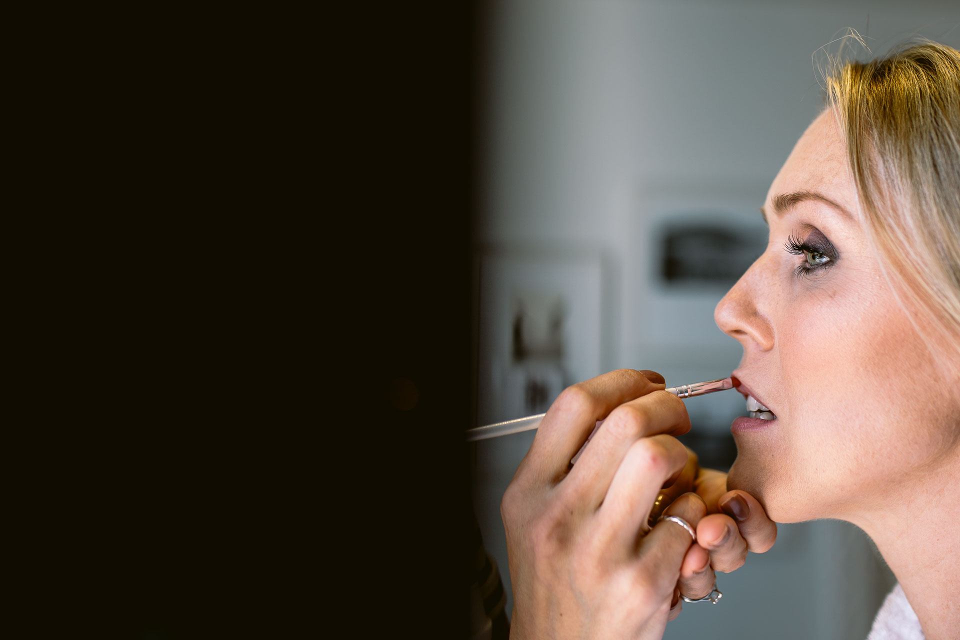bride having her make up done for the salcombe harbour hotel wedding