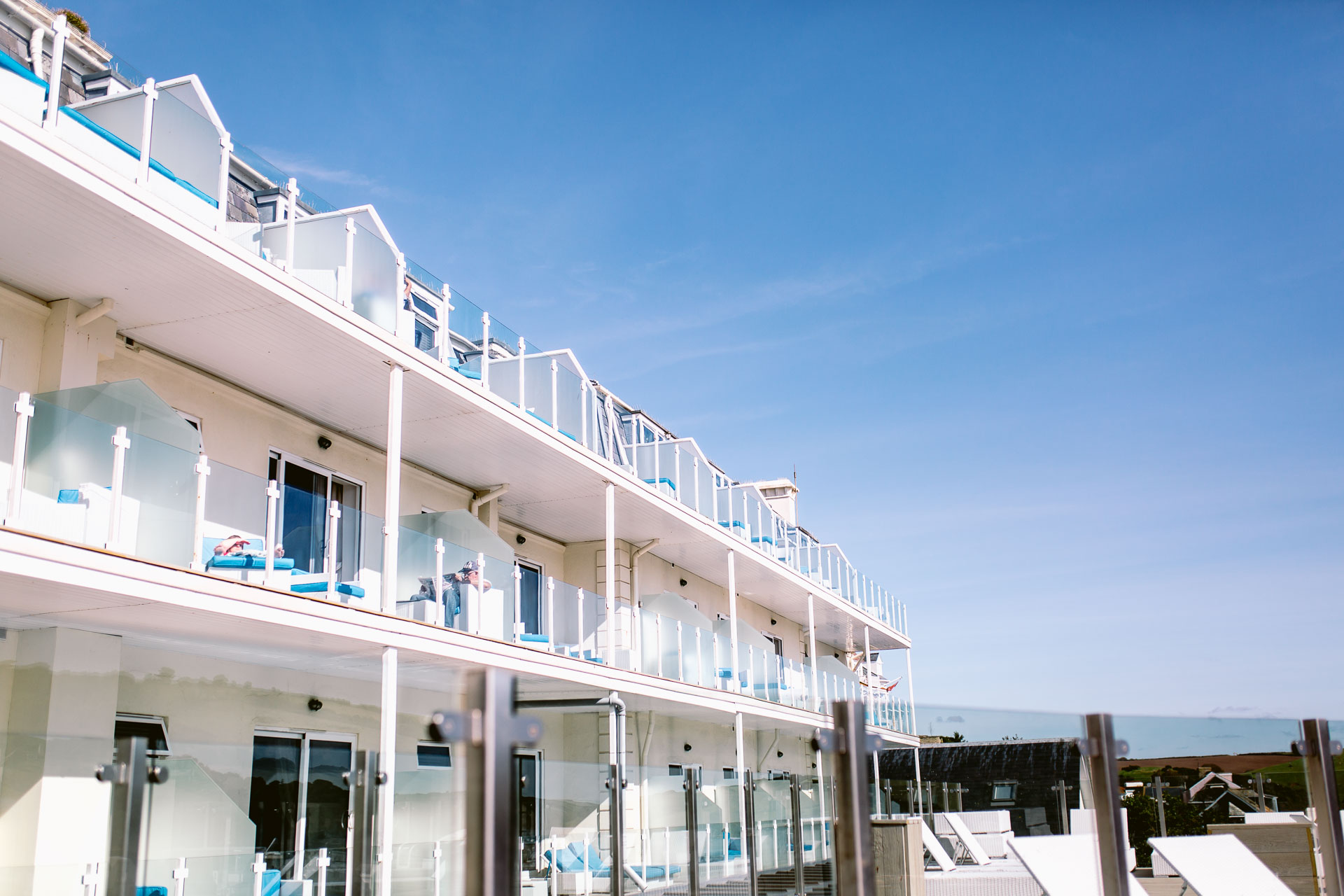 Salcombe Harbour Hotel with the blue sky at a wedding go Hoeard + Ruth