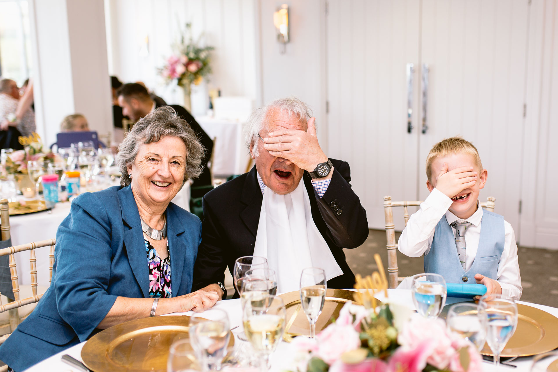 guests playing hide and seek in salcombe harbour hotel wedding