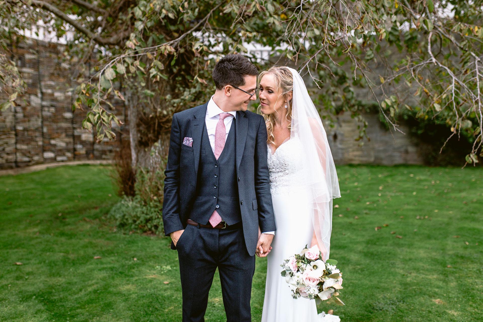 bride and groom standing and hugging in Salcombe harbour hotel wedding