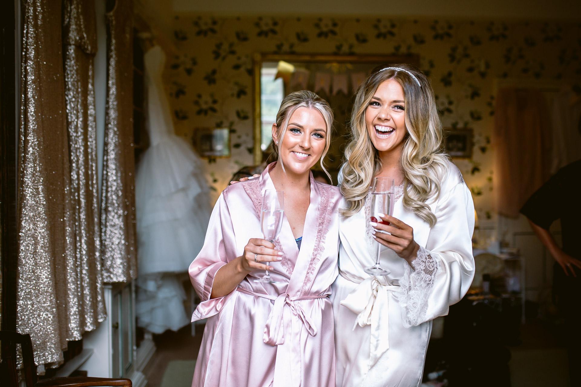 bride and bridesmaid having a hug and a laugh at Fonmon Castle