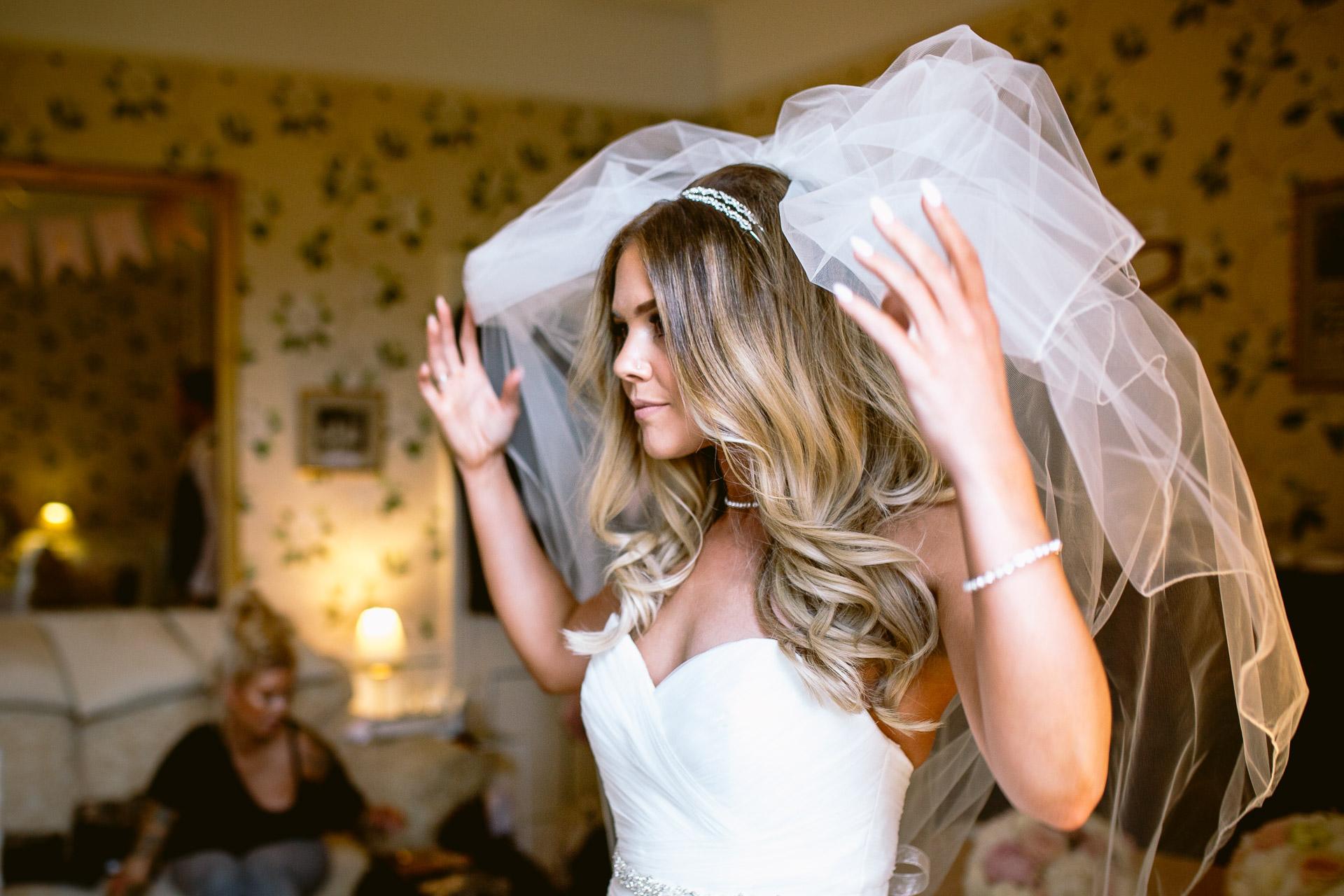 bride fluffing her veil in Fonmon Castle