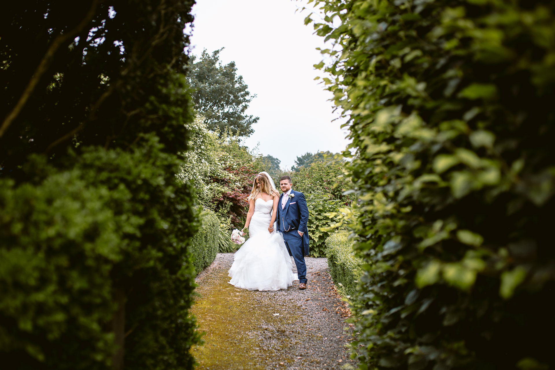 bride and groom standing in the gardens on Fonmon Castle