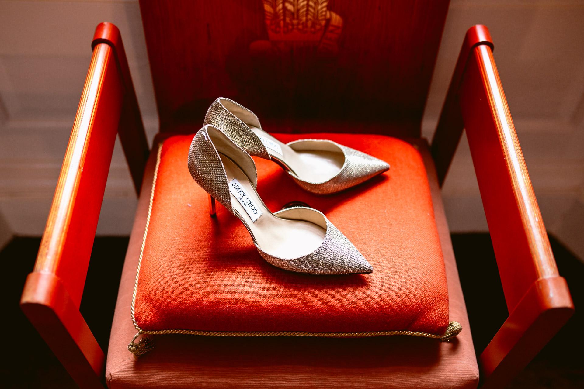 bridal shoes Jimmy Choo standing on the orange cushion in Fonmon Castle