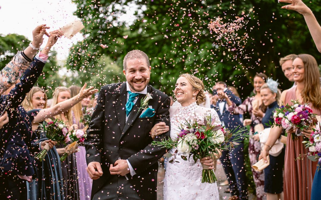 bride and groom walking down the aisle of confetti throw on norwegian wedding