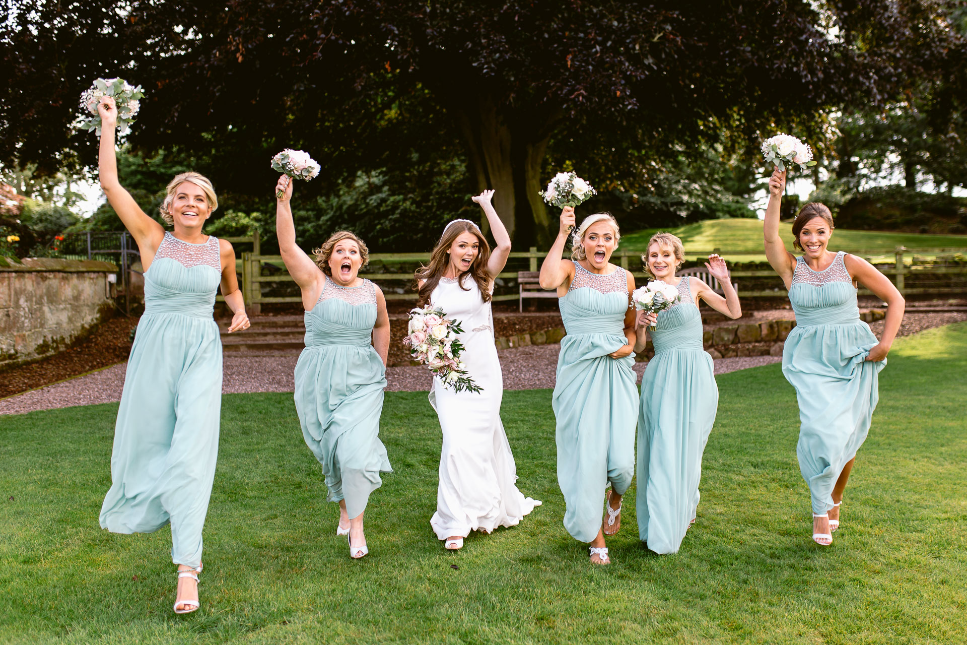 The Citadel wedding Shropshire Sarah_Jane and Steve bridesmaids running with bouquets