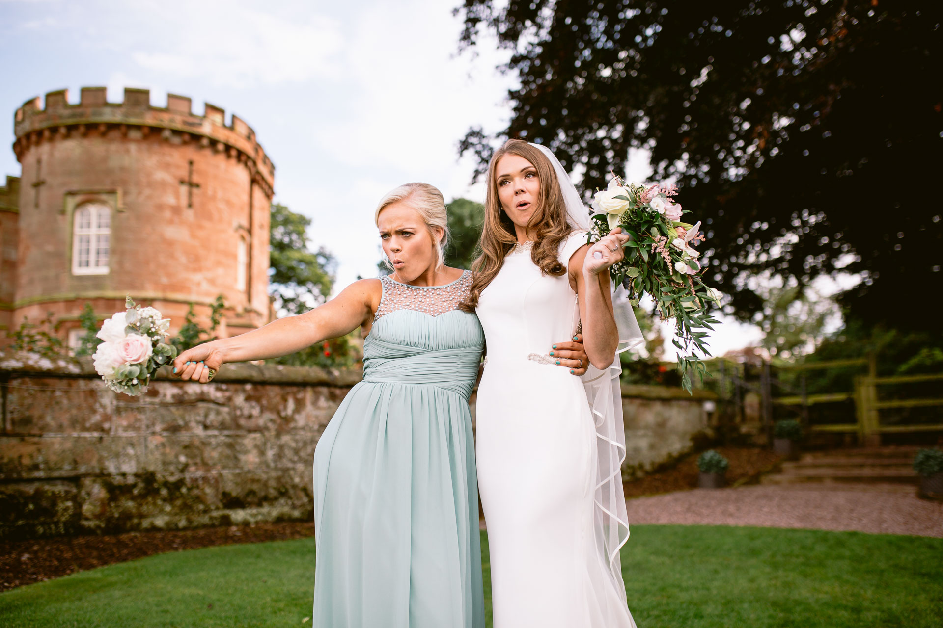 The Citadel wedding Shropshire Sarah-Jane and Steve bride and her sister making silly pose and posing