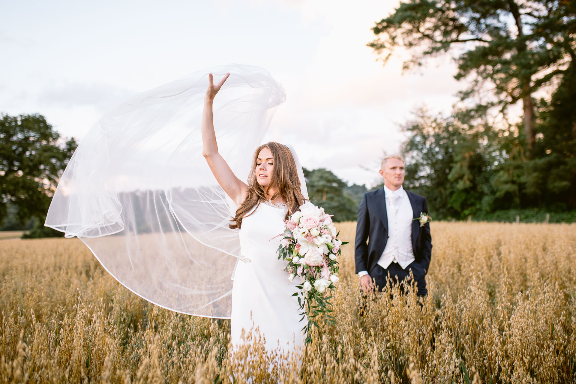 The Citadel wedding Shropshire Sarah_Jane and Steve bride and groom standing in the fields and throwing the veil