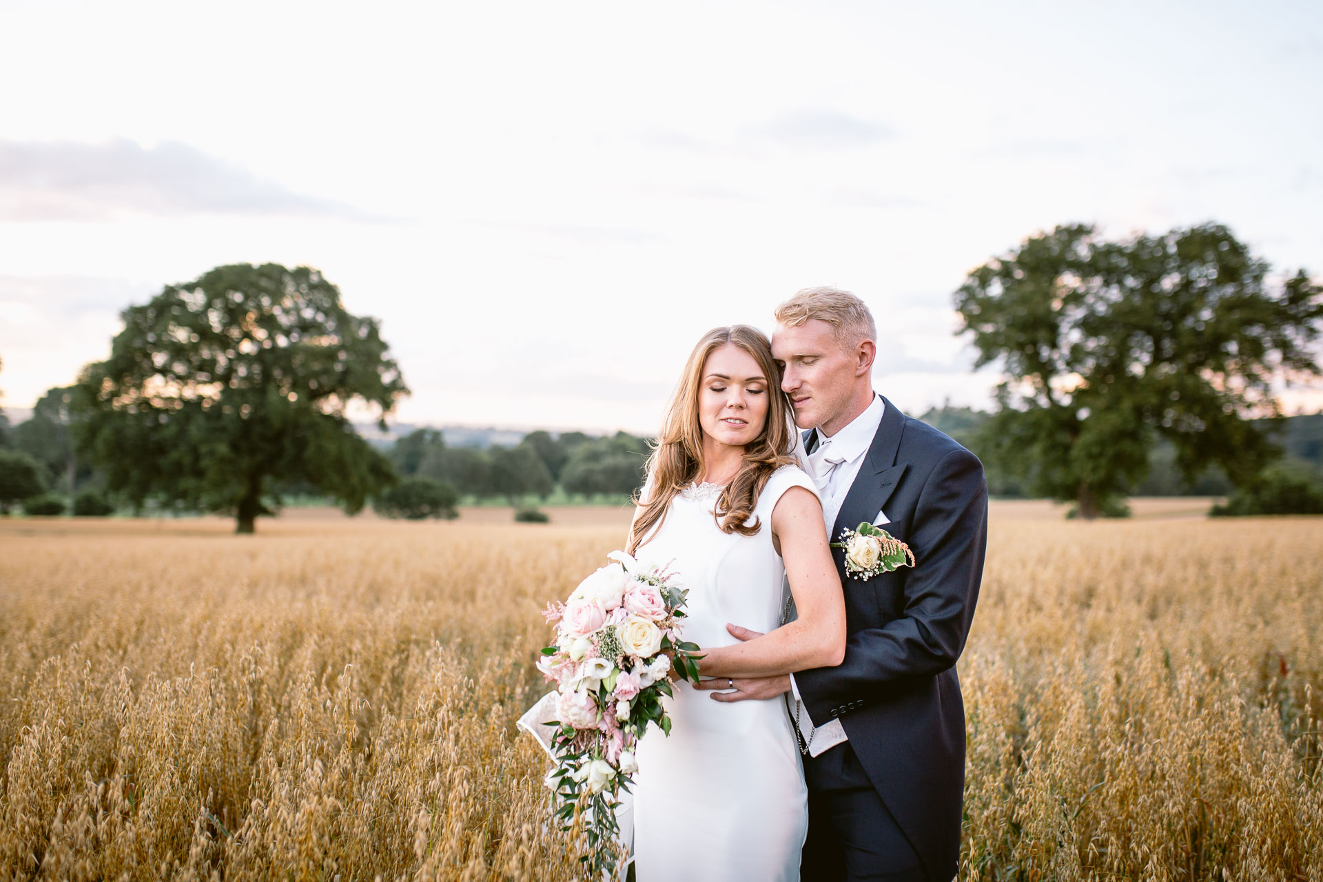 The Citadel wedding Shropshire Sarah-Jane and Steve bride and groom standing in the fields of gold