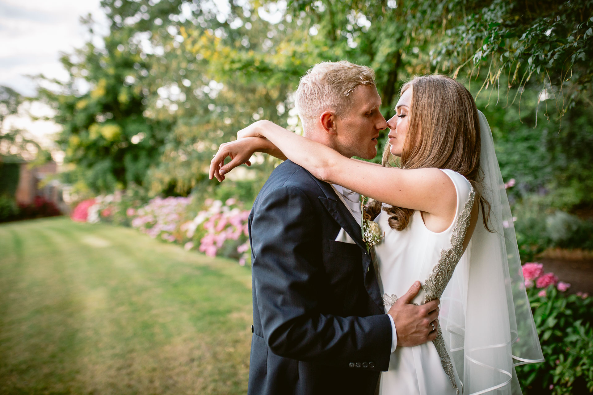 The Citadel wedding Shropshire Sarah_Jane and Steve brie and groom embracing each other and kissing in the garden