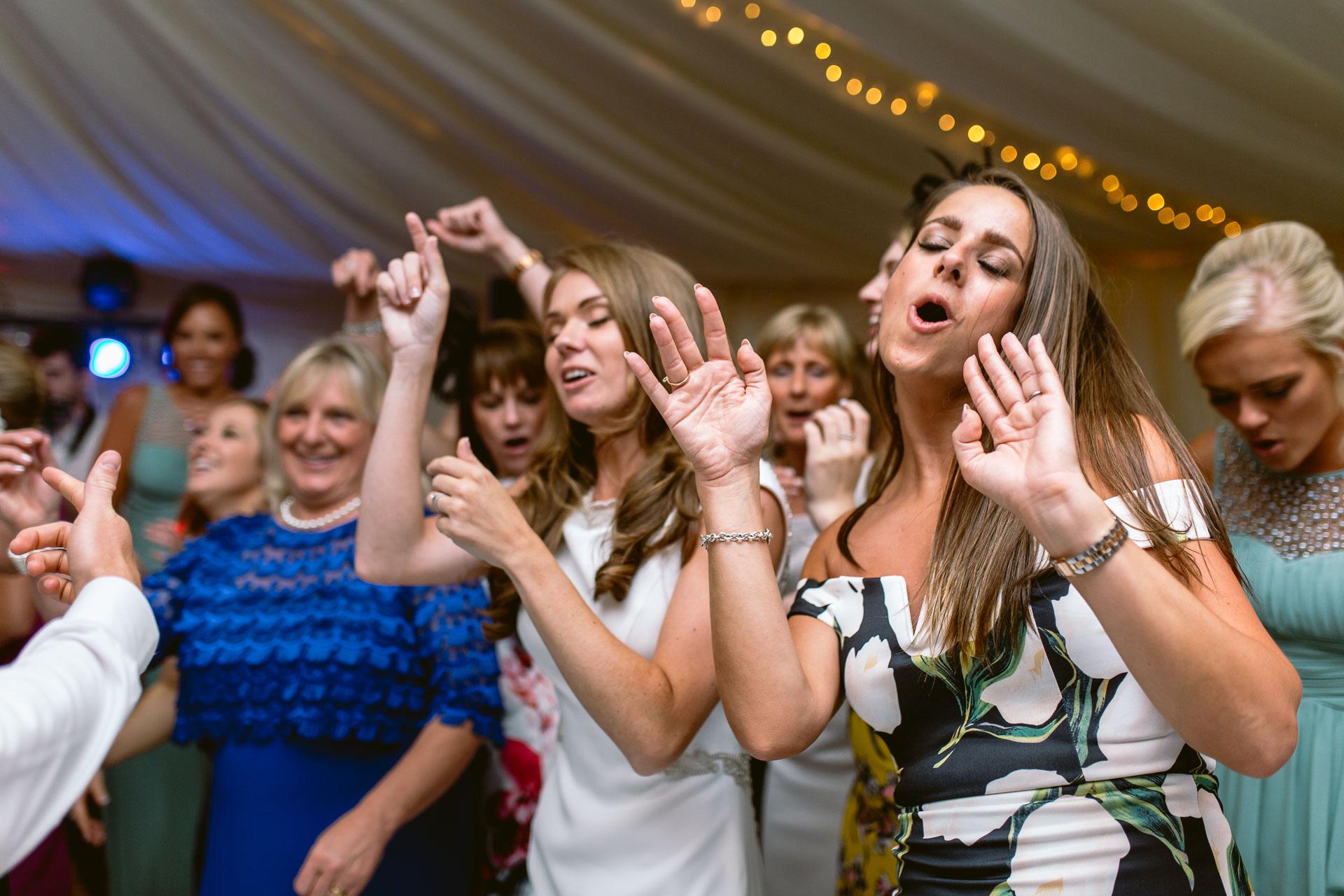 The Citadel wedding Shropshire Sarah-Jane and Steve wedding guests dancing crazy on the dance floor